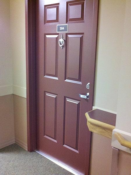Margaret Wagner Apartments room #304 door with door knocker