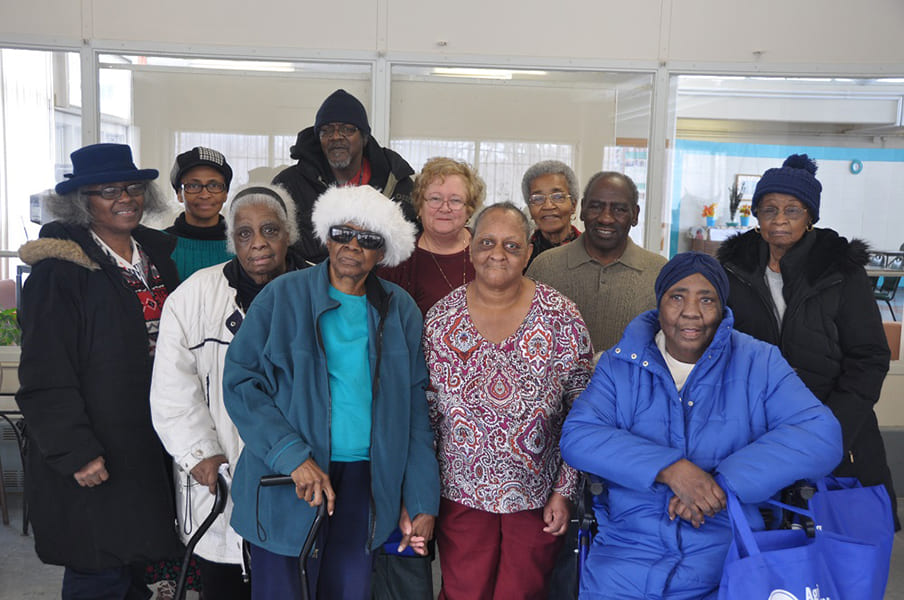Ten Rose Center participants smiling with the group facilitator of the Heart Health Program