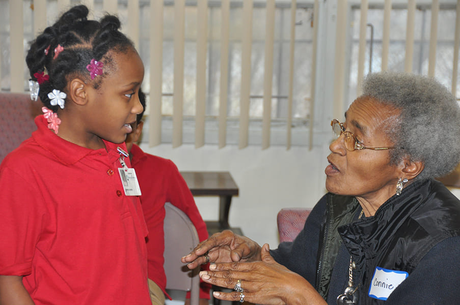 Rose Centers participant talking with young child