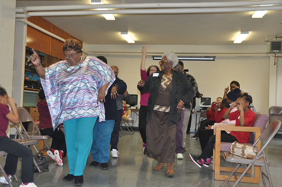 Rose Centers participants line dancing and laughing
