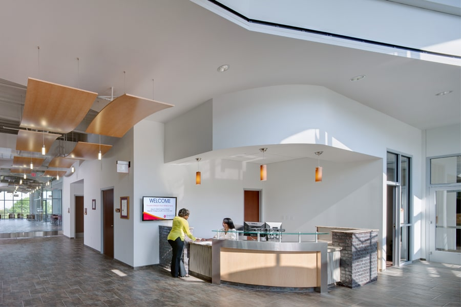 Reception desk in lobby at Benjamin Rose Institute on Aging Headquarters