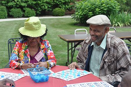 Adult Day Program- Two Adult Day Program participants enjoying a game of bingo outdoors