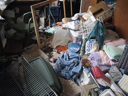 Household items and clothing on the floor of a room